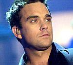 Robbie Williams Holds Bedside Vigil For Ill Mother