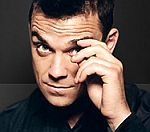 Robbie Williams To Take On X Factor Winner In Race For Christmas Number One