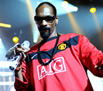 Snoop Dogg Takes On Manchester United's Rio Ferdinand At Football