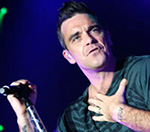 Robbie Williams Hits Out At Take That Reunion Doubters